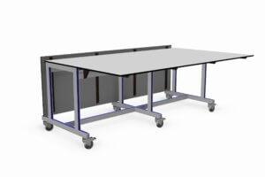 verrijdbare werktafel voorzien van wegklapbare werkbladen